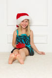 Little girl in the santa claus hat Stock Photo