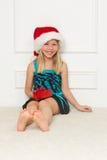 Little girl in the santa claus hat. Cute little girl in the santa claus hat Stock Photo