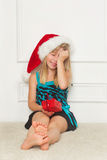 Little girl in the santa claus hat. Cute little girl in the santa claus hat Royalty Free Stock Photo