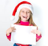 Little girl in Santa Claus hat Royalty Free Stock Image