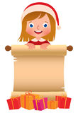 Little girl in Santa Claus hat with a scroll and boxes of Christmas gifts Royalty Free Stock Images