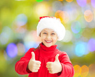 Little girl in a Santa Claus hat Stock Images
