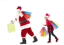 Little girl and santa claus holding shopping bags Stock Photos