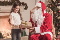 Little girl and Santa Claus Royalty Free Stock Images