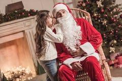 Little girl and Santa Claus Stock Photos