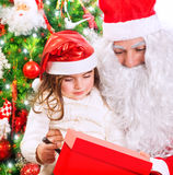 Little girl with Santa Claus Royalty Free Stock Photos