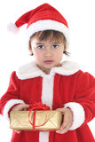Little girl in santa clothes with gift Royalty Free Stock Image