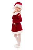 Little girl in Santa costume. Stock Photos