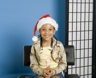 Little girl with a santa hat Royalty Free Stock Image