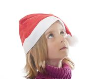 Little girl with santa hat Stock Photos