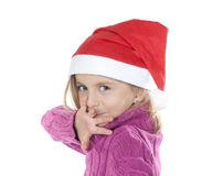 Little girl with santa hat Royalty Free Stock Images