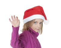 Little girl with santa hat Stock Image