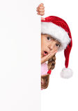 Little girl in Santa hat Royalty Free Stock Images