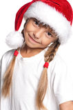 Little girl in Santa hat Stock Images