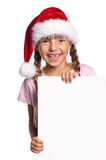 Little girl in Santa hat Stock Photography