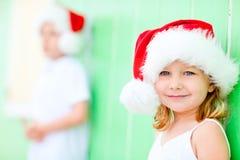Little girl in Santa hat Stock Images