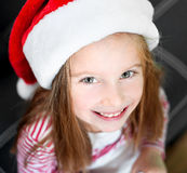 Little girl with santa hat Stock Images