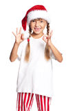 Little girl in Santa hat Stock Photo