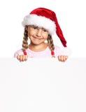 Little girl in Santa hat. Portrait of happy little girl in Santa hat with white blank stock photos