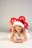 Little girl with Santa hat Royalty Free Stock Photos