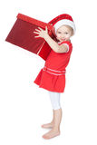 Little girl in santa hat with big red gift on whit Royalty Free Stock Photography