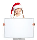 Little girl in Santa hat with blank board Royalty Free Stock Image