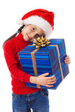 Little girl in Santa hat with blue box Stock Photo