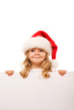 Little girl with santa hat and cardboard banner Stock Images