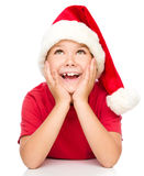 Little girl in santa hat is daydreaming Royalty Free Stock Photos