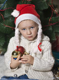 Little girl in Santa hat Stock Photo