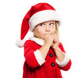 Little Girl in Santa Hat dreaming on Xmas Gifts Stock Photo