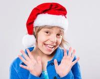 Little girl in santa hat Royalty Free Stock Image