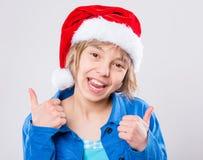 Little girl in santa hat Stock Image
