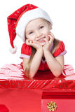 Little girl in santa hat with gift on white Royalty Free Stock Photography