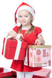 Little girl in santa hat with gifts on white Stock Photography