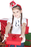 Little girl in santa hat with gifts on white Royalty Free Stock Image