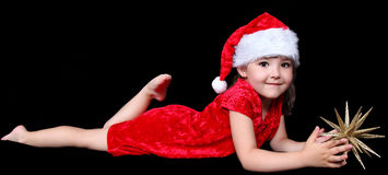 Little girl in santa hat with golden star Royalty Free Stock Image