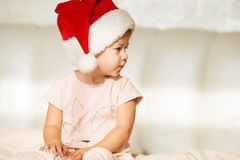 Little girl in santa hat. half-face Portrait of beautiful baby g Stock Image