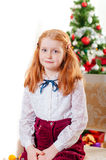 Little girl in santa hat near Christmas tree Royalty Free Stock Photos