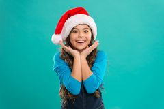 Little girl in santa hat. New year party. Santa claus kid. Happy winter holidays. Small girl. Christmas is the time to. Please. Present for Xmas. Childhood royalty free stock photo