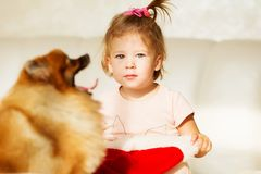 Little girl in santa hat. Portrait of beautiful baby girl playin Royalty Free Stock Photos