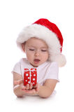Little girl with santa hat and red gift box Royalty Free Stock Images