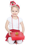 Little girl in santa hat with red gift on white Royalty Free Stock Image