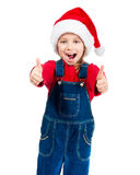 Little girl in santa hat show the thumb Stock Photography