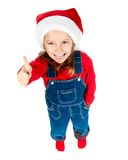Little girl in santa hat show the thumb Stock Images