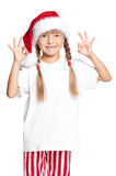 Little girl in Santa hat showing ok Royalty Free Stock Photo