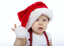 Little girl with santa hat on white background Royalty Free Stock Images