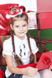 Little girl in santa helper hat with red gift Royalty Free Stock Photo