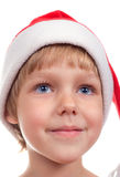 Little girl with Santa's hat Stock Photography