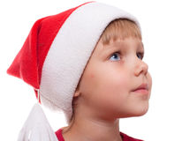 Little girl with Santa's hat Stock Image
